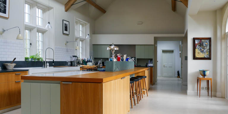 A mixture of Oak and painted cabinets feature in this large family kitchen in Boxford.