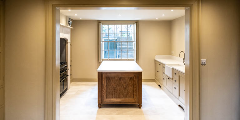 Oak island provides a central focal-point for this period sypathetic kitchen in Central Cheltenham.